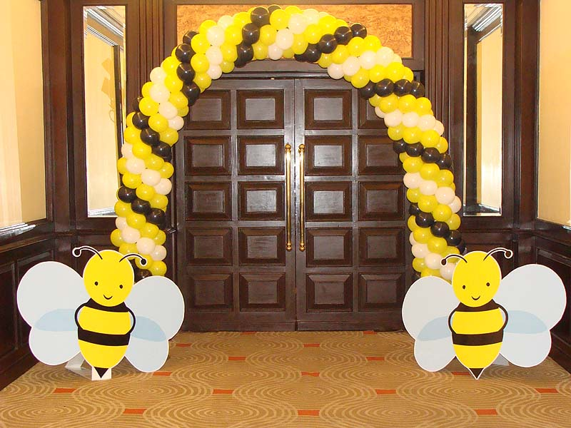 entrance balloon arch with bumblebee cutouts bumble bee