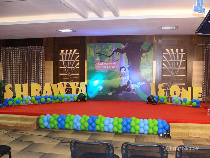 Stage decor peacock theme for 1st birthday hall decoration