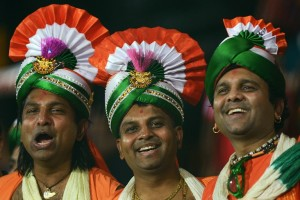 Jovial fans sporting a tri-colored turbans